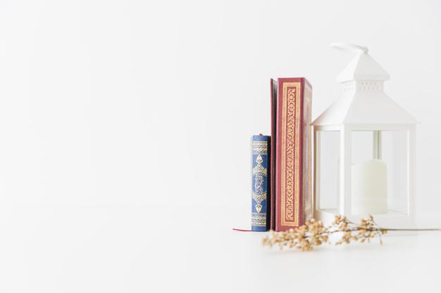 koran-books-with-lantern-branch_23-2147871912